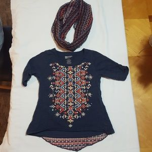 Girls med size 10/12 shirt and scarf.